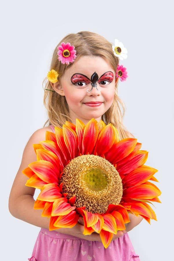 Gesichtsmalerei, Marienkäfer stockfoto