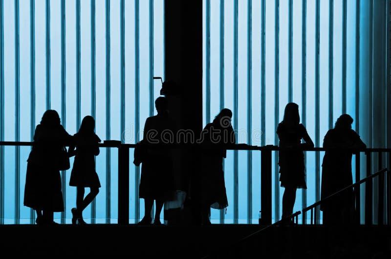 Gesilhouetteerde mensen in de bouw stock afbeeldingen