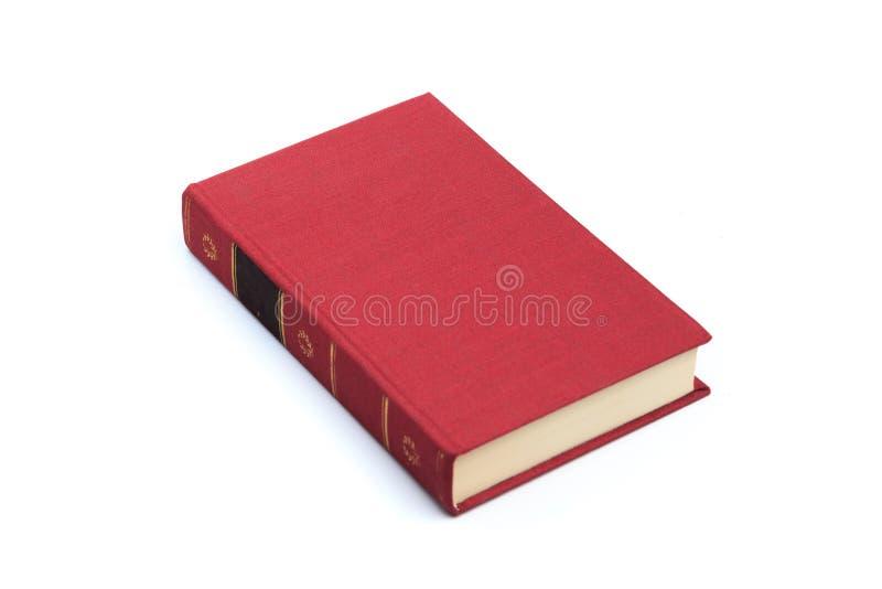 Gesloten rood boek geïsoleerd op een witte achtergrond royalty-vrije stock afbeeldingen