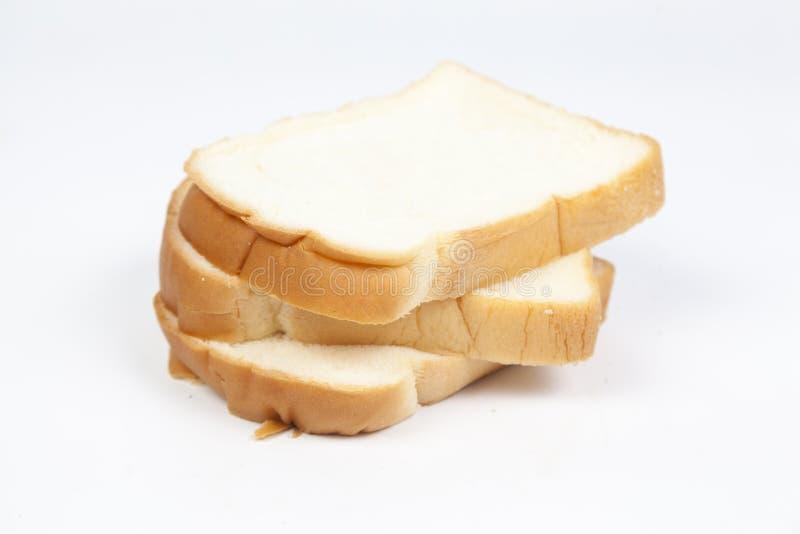 Gesneden brood †‹â€ ‹op een witte achtergrond stock foto's