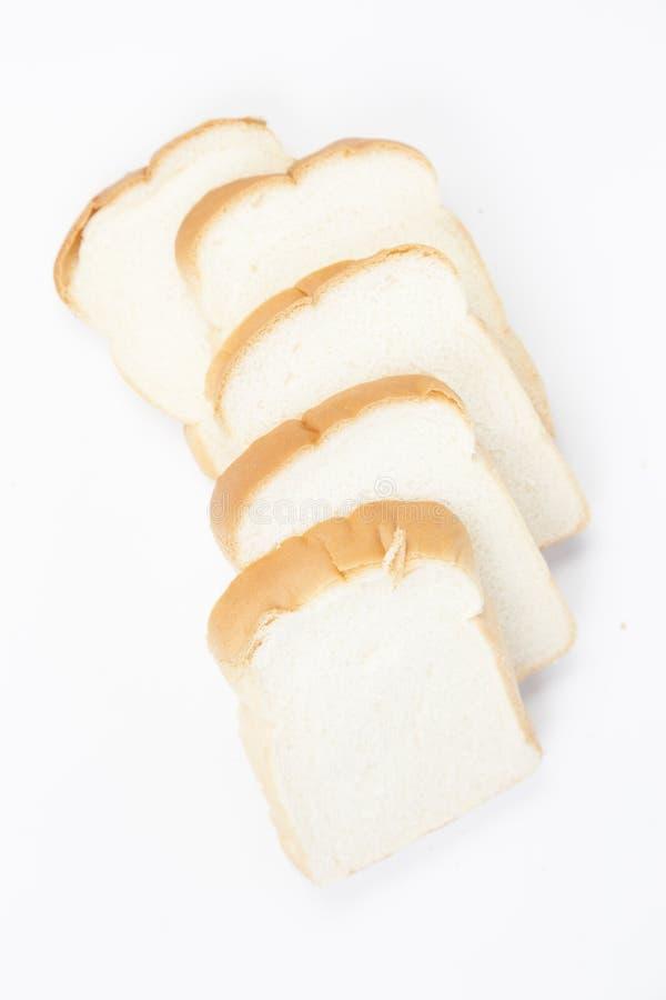 Gesneden brood †‹â€ ‹op een witte achtergrond stock afbeeldingen
