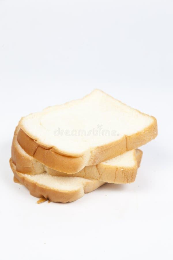 Gesneden brood †‹â€ ‹op een witte achtergrond stock afbeelding
