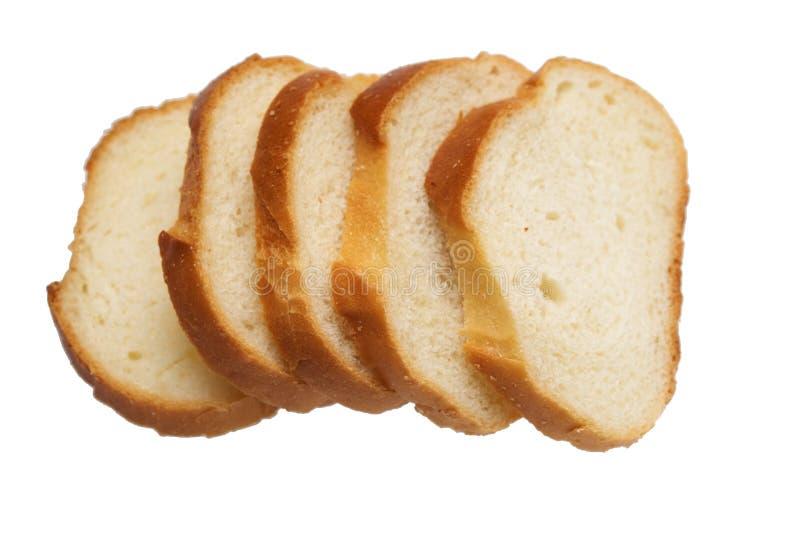 Gesneden brood dat op het wit wordt geïsoleerd stock afbeelding
