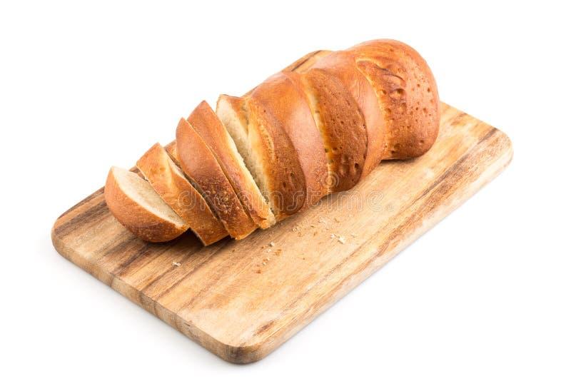 Gesneden brood op een houten hakbord royalty-vrije stock foto's