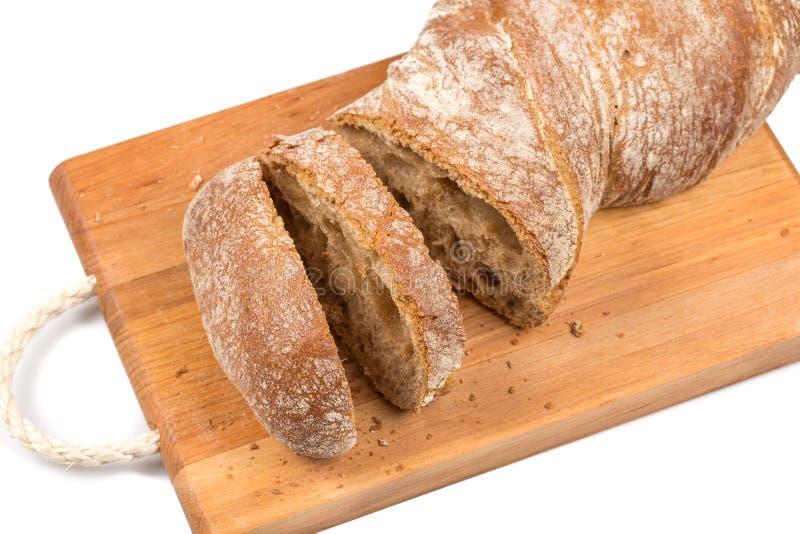Gesneden brood op scherpe raad royalty-vrije stock foto's