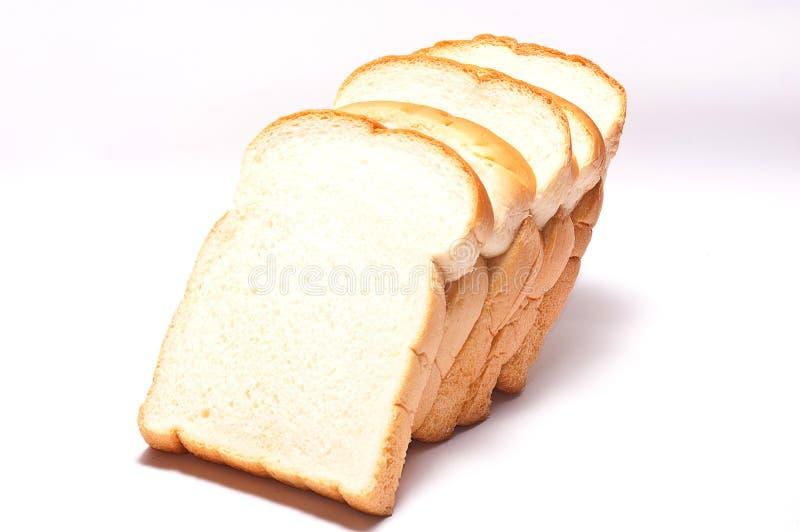 Gesneden brood op witte achtergrond stock foto's
