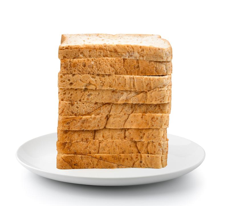 Gesneden brood in plaat op een witte achtergrond royalty-vrije stock foto's