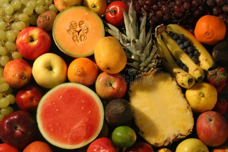 Gesneden Fruit en Geheel Fruit royalty-vrije stock afbeelding