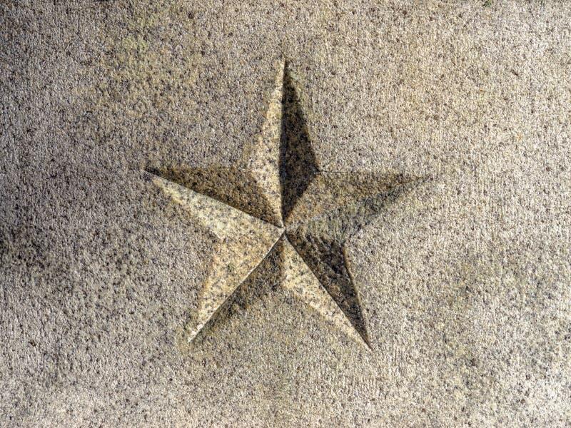 Gesneden 5-gerichte Ster in Graniet stock foto