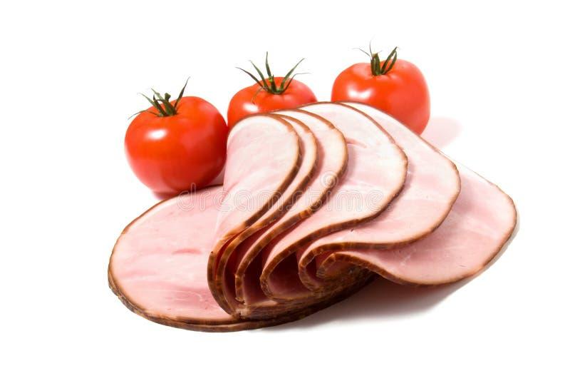 Gesneden gerookt vlees dat op witte achtergrond wordt geïsoleerdt royalty-vrije stock foto