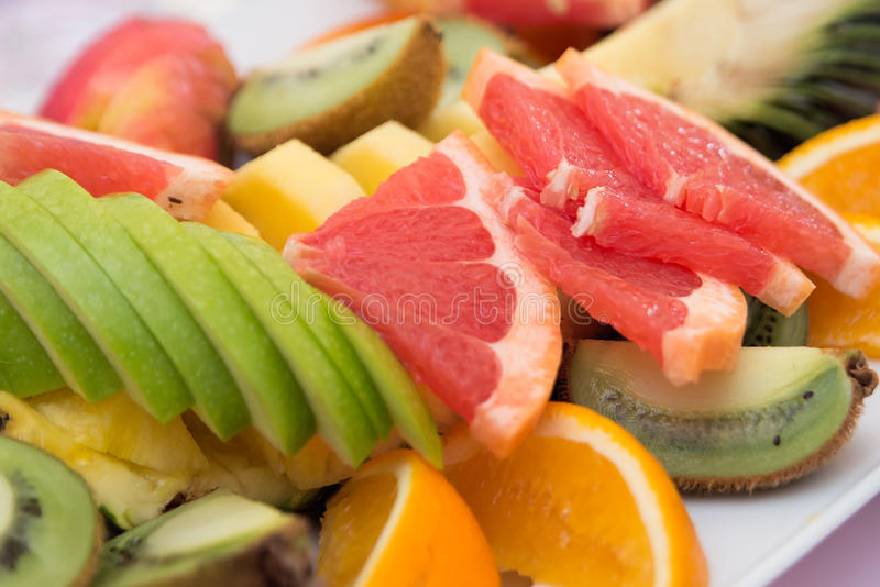 Gesneden grapefruit en appel Verse Vruchten stock foto