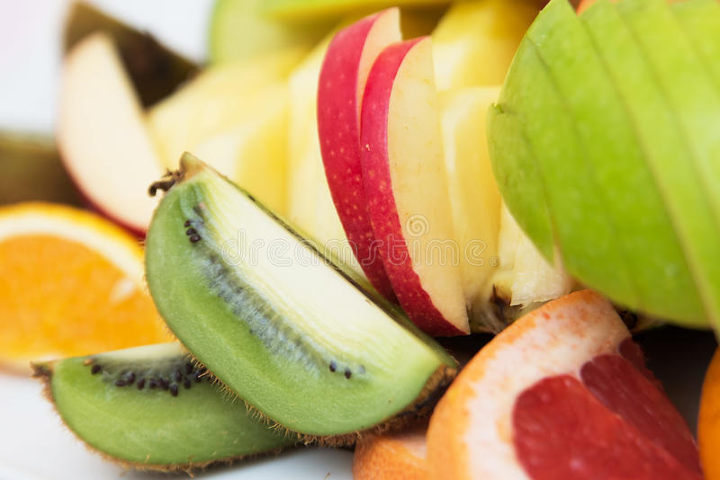 Gesneden grapefruit en appel Verse Vruchten royalty-vrije stock afbeeldingen