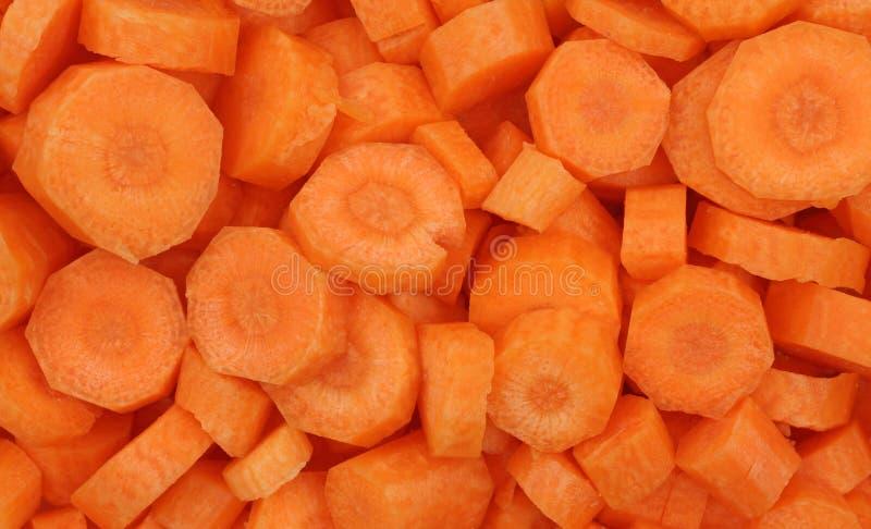 Gesneden organische wortelen stock afbeelding