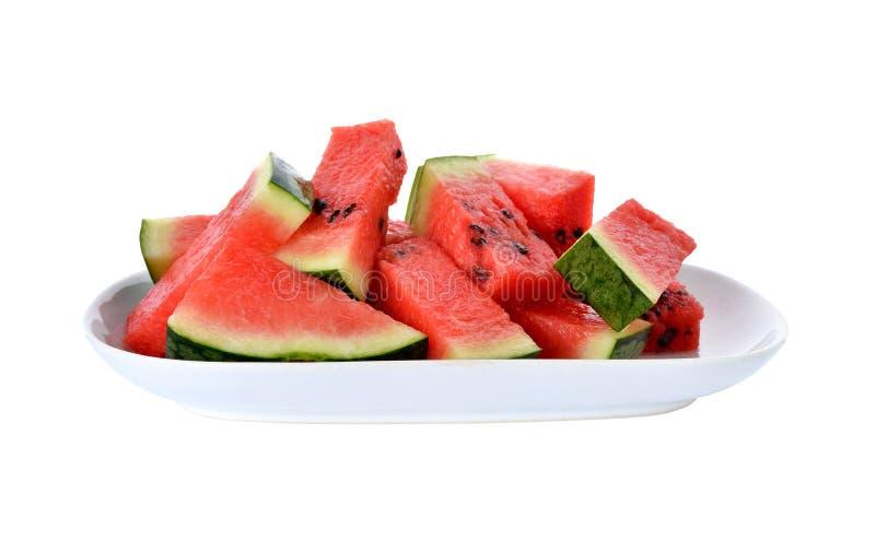 Gesneden watermeloen op plaat met wit stock fotografie
