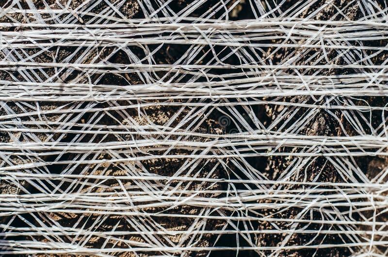 Gesponnener Sack mit Brennholznahaufnahmehintergrund lizenzfreie stockfotografie