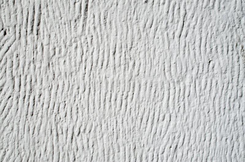 Gesso decorativo bianco di sollievo sulla parete fotografie stock