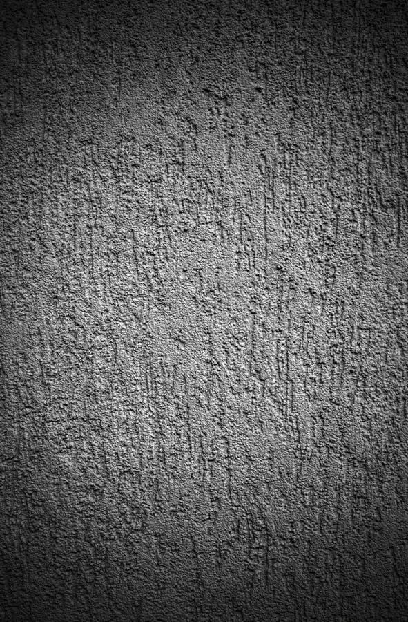 Gesso decorativo di sollievo sulla parete in bianco e nero immagini stock
