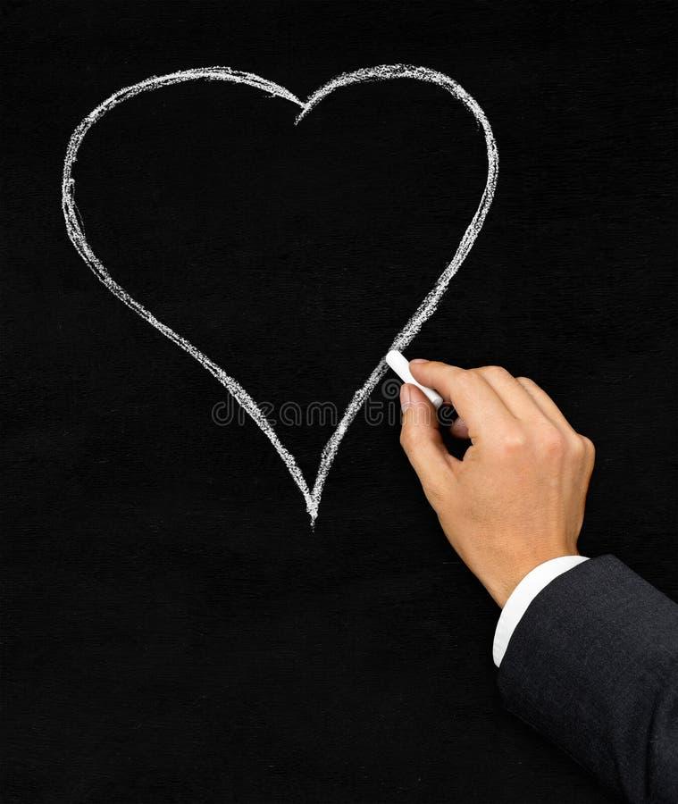 Gesso del cuore che attinge lavagna immagine stock