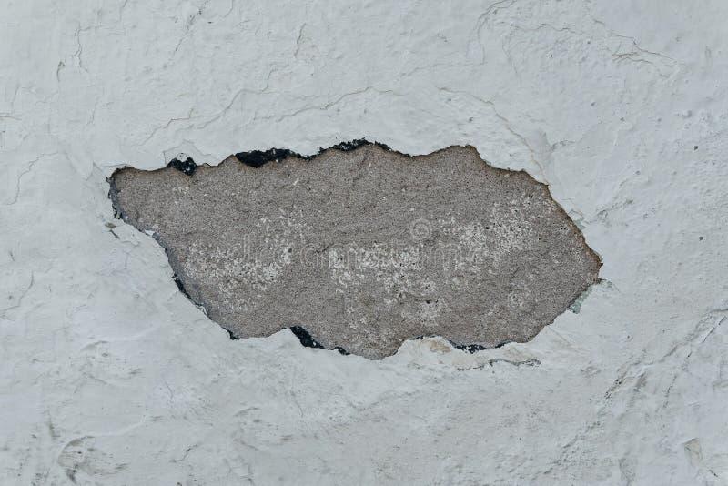 Gesso scheggiato del cemento, primo piano di struttura della parete fotografie stock libere da diritti