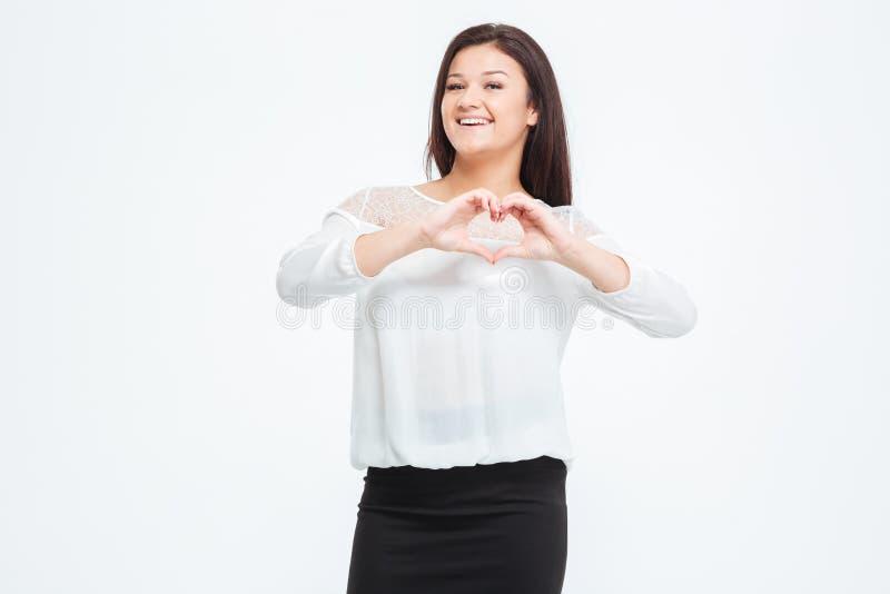 Gest för affärskvinnavisninghjärta med fingrar royaltyfria foton