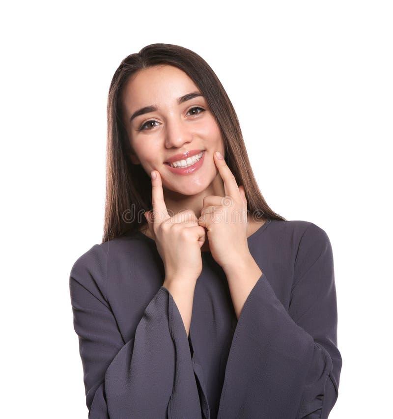Gest för kvinnavisningSKRATT i teckenspråk royaltyfria foton