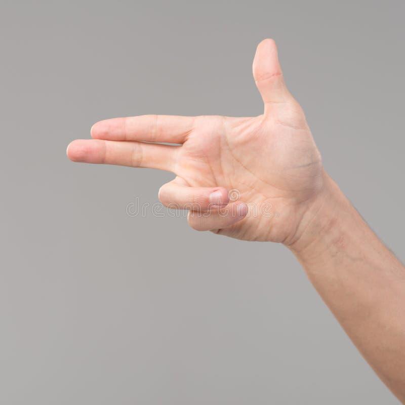 Gest för pistol för fingerteckenhand arkivfoto