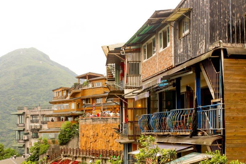 Gestalten Sie Jiufen-Dorf-Abhanggebäude auf dem Berg landschaftlich lizenzfreies stockfoto