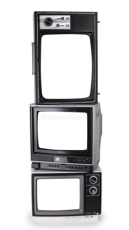 Gestapelde retro televisies stock afbeeldingen