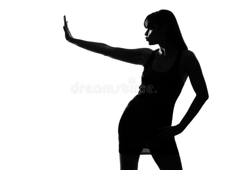 Geste élégant d'arrêt de femme de silhouette photo stock