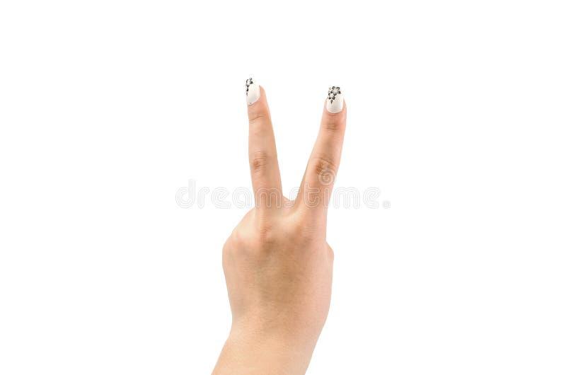 Geste de signe de victoire de main d'isolement sur le fond blanc photographie stock
