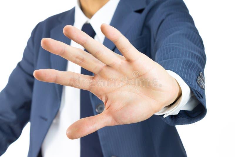 Geste de Stop Sign Hand d'homme d'affaires sur la vue d'inclinaison d'isolement sur Pentecôte images libres de droits