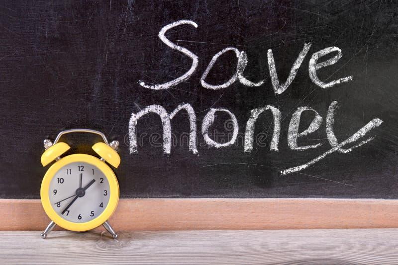 Gestión de tiempo para el concepto de ahorro del dinero imagenes de archivo