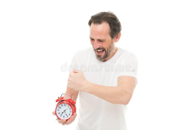 Gestión y disciplina de tiempo Puntualidad y responsabilidad Hombre con el reloj en el fondo blanco Sufra de régimen fotos de archivo libres de regalías