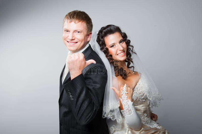 Gesticulating bride and groom stock photography