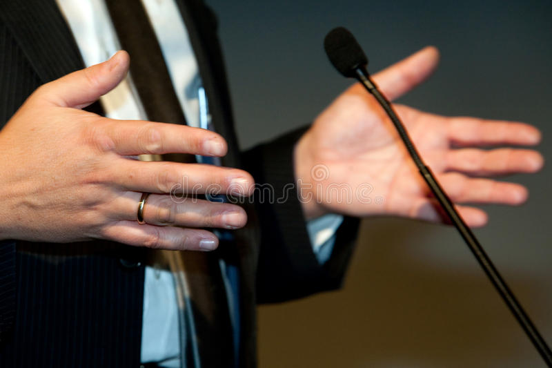 Gesticulation. Businessman gesticulation in a conference royalty free stock photos