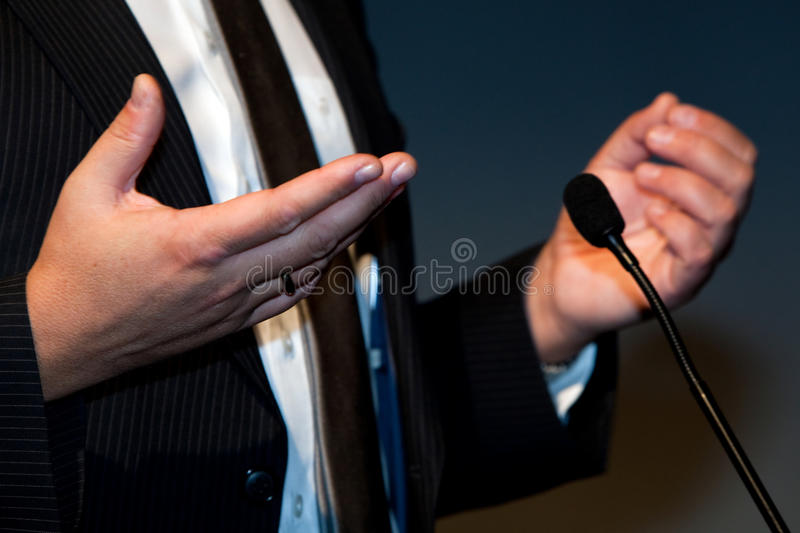 Gesticulation. Businessman gesticulation in a conference stock photo