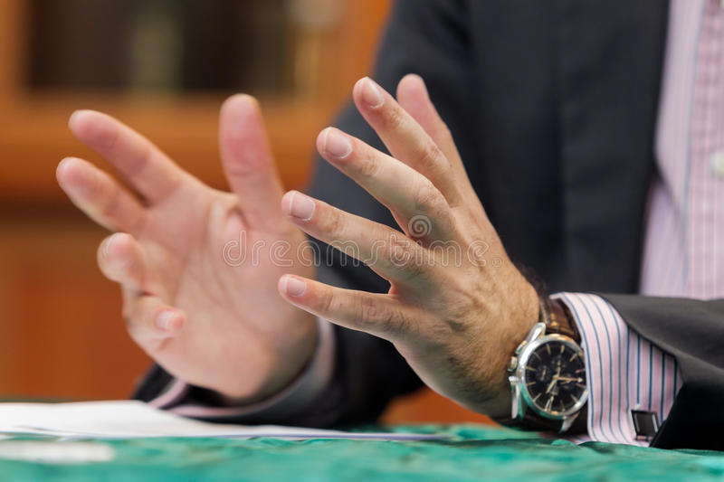 Gesticulation hands. Businessman gesticulation in a press conference royalty free stock image