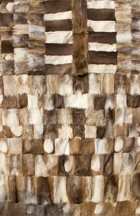 Gestikte samen stukken van dierlijk bont stock afbeelding