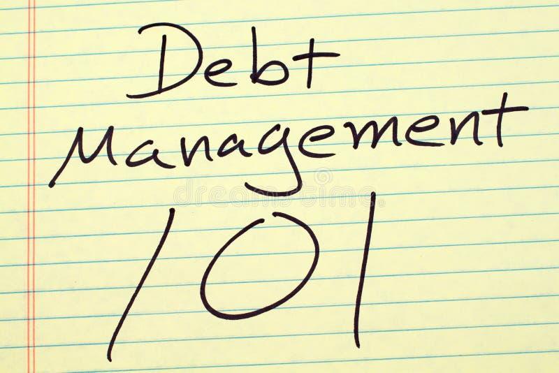 Gestione di debito 101 su un blocco note giallo immagini stock