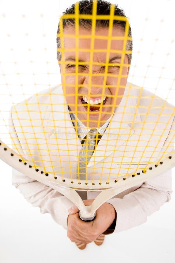 Gestionnaire regardant par la raquette image libre de droits