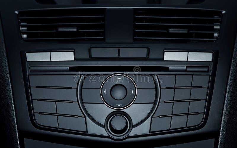 Gestisca i bottoni in automobile moderna fotografia stock