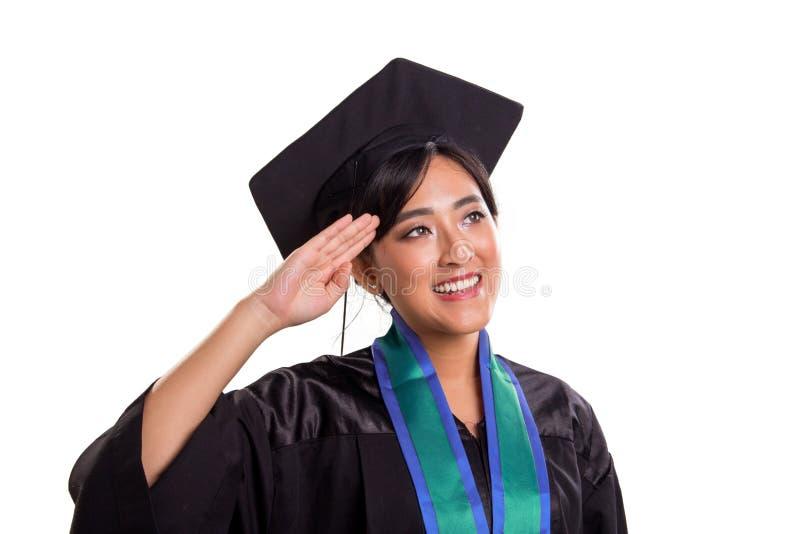 Gesto bonito da saudação de mão do aluno diplomado lateralmente, isolado no branco foto de stock