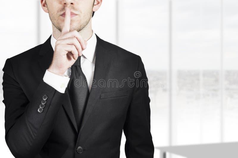 Gesto calmo silenzioso dell'uomo d'affari fotografia stock libera da diritti