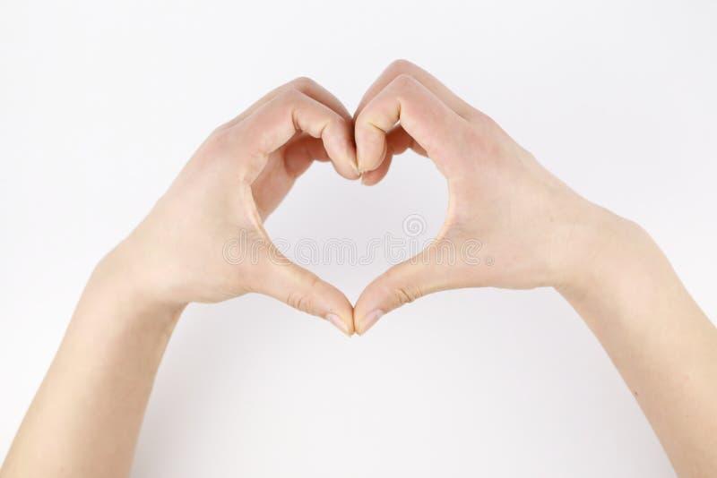 Gesto de la mano abierta de la mujer del amor en el fondo blanco fotos de archivo libres de regalías