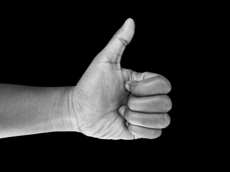 Gesto de mão dos polegares acima, isolado no fundo preto fotografia de stock royalty free