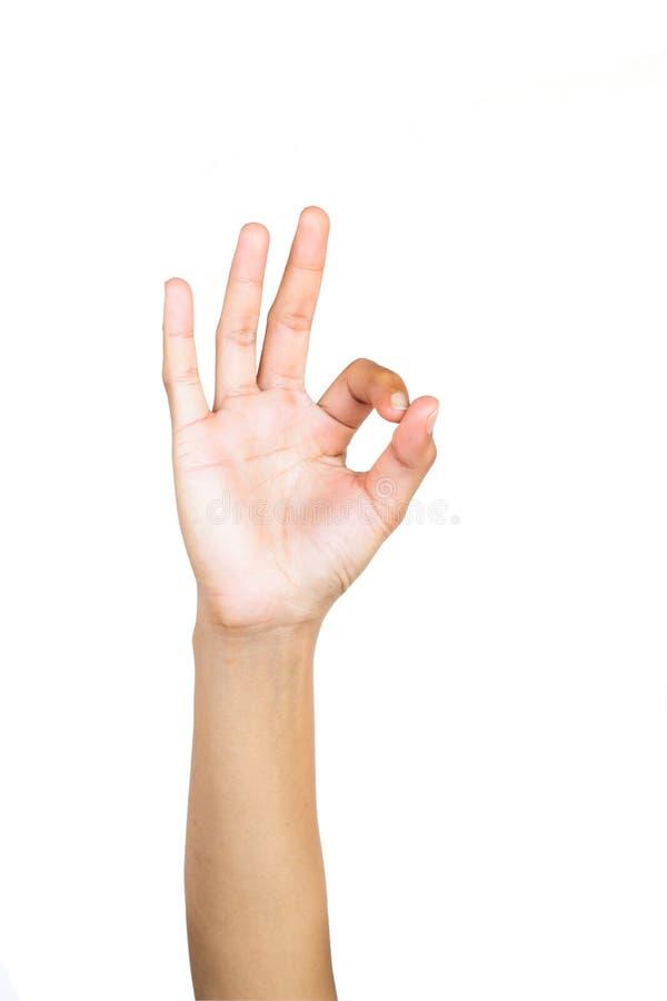 Gesto de mão fêmea que faz a ` o sinal APROVADO do ` no fundo branco imagens de stock royalty free