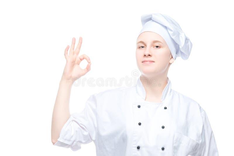 Gesto de mano femenino de la demostración del cocinero, retrato satisfecho en blanco fotos de archivo