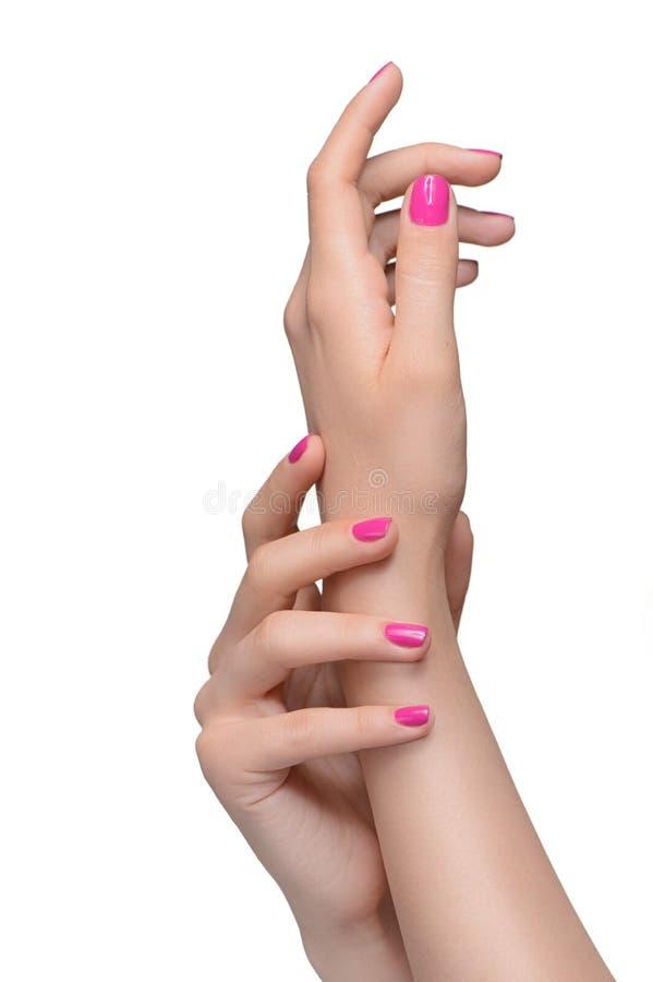 Gesto de manos. Primer de las manos femeninas que gesticulan mientras que está aislado imagen de archivo
