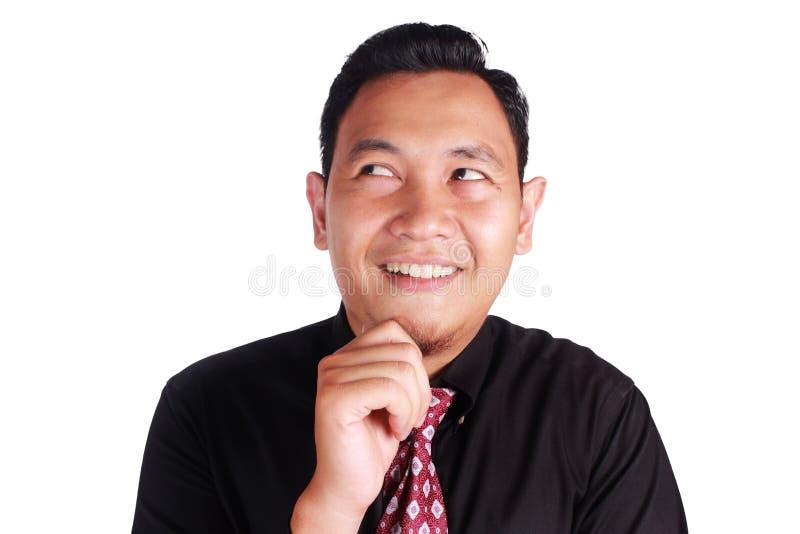 Gesto de pensamento do homem de negócios engraçado novo fotos de stock