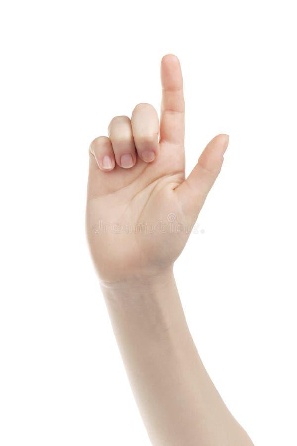 Gesto del touch screen della mano della giovane donna verso la macchina fotografica fotografie stock